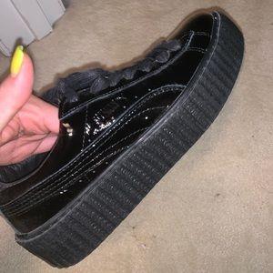 Brand new black leather pumas never worn